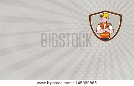 Business Card showing Illustration of a builder carpenter construction worker arms folded holding hammer looking to the side set inside shield crest on isolated background done in cartoon style.