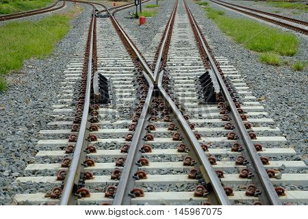 Two railways tracks merge close up.Industrial concept.