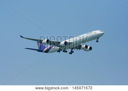 CHIANGMAI , THAILAND - MARCH 31 2009: HS-TNC Airbus A340-600 of Thaiairway. Landing to Chiangmai airport from Bangkok Suvarnabhumi.