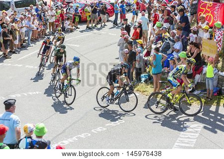 Col du Glandon France - July 23 2015: Group of cyclists riding on the road to Col du Glandon in Alps during the stage 18 of Le Tour de France 2015.