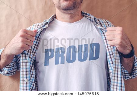 Guy revealing his shirt with proud title pride and arrogance concept.