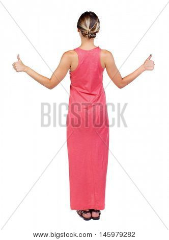 Back view of woman thumbs up. Rear view people collection. backside view of person. A slender woman in a long red dress showing a thumbs up with both hands.