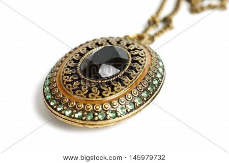 Brass medallion isolated with clipping path on white background