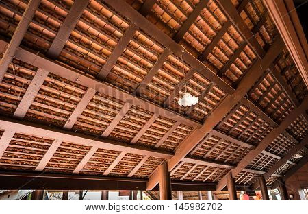 the wooden structure under the clay roof use so many small pieces of long wood to support all the clay roof tile