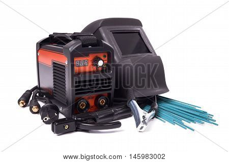 Inverter welding machine, welding equipment, isolated on a white background, welding mask, welding electrodes, high-voltage wires with clips, set of accessories for arc welding
