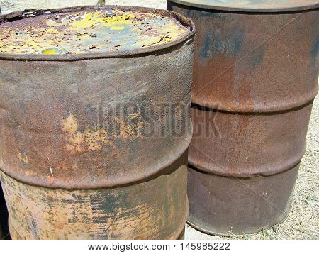 Old rusty fuel cans detail - in a junkyard