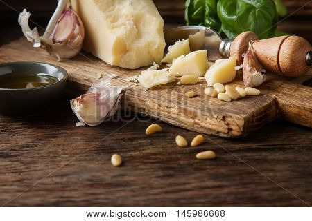 Italian Parmesan Cheese With Knife Fresh Green Basil, Olive Oil,