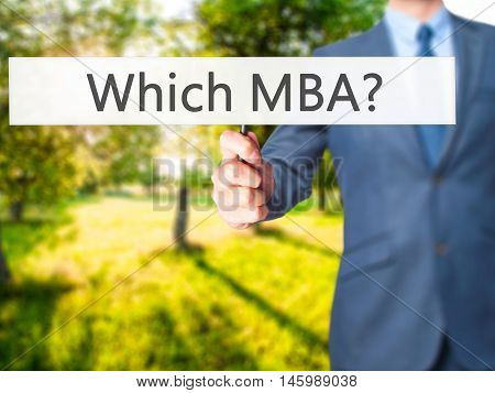 Which Mba? - Businessman Hand Holding Sign