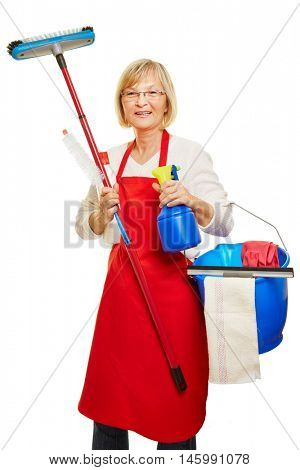 Housewife doing spring cleaning with many cleaning supplies in her hands