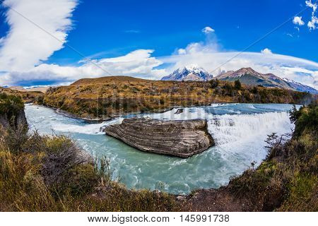 Emerald Paine river forms a cascading waterfalls. Torres del Paine National Park - Biosphere Reserve. Chile, Patagonia, Paine Cascades