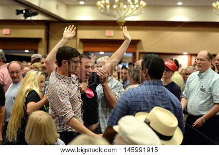 Chesterfield, MO, USA - September 06, 2016: A protester is taken out of event at Pence rally for Trump in Chesterfield, Missouri.