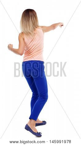 back view of standing girl pulling a rope from the top or cling to something. Rear view people collection. backside view of person. Isolated over white background. The blonde in a pink shirt boxing.