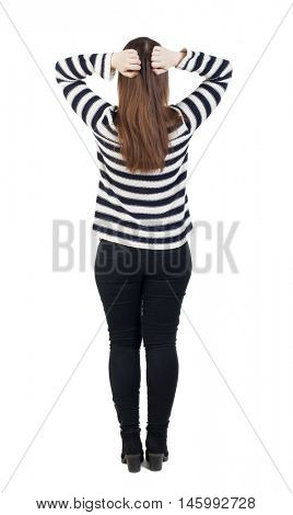 Back view of shocked woman in jeans. girl hid his eyes behind his hands.  Rear view people collection.  backside view of person.  Isolated over white background. The girl in the striped sweater is
