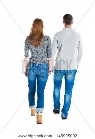 Back view going couple. walking friendly girl and guy holding hands. Rear view people collection. backside view of person. Isolated over white background.  Man and woman holding hands going forward