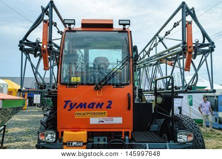 Tyumen, Russia - June 24, 2016: The 5th open championship of Russia on plowed land. Sprayer spreader self-propelled Tuman-2 for entering of fertilizer in liquid and granulated form