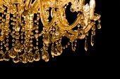 Luxury chandelier with light candles and right dark background. Noble candelabra hanging on ceiling with lots of little gems. poster