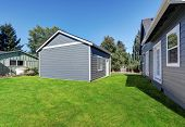 Blue clapboard siding house with matching detached garage Northwest USA poster