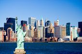 Statue of Liberty overlooking lower Manhattan and New York harbor poster