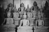 other of Buddha statue buddha image used as amulets of Buddhism religion black and white high contrast picture style selective focus poster