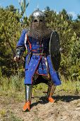 Mongol horde warrior in armour holding traditional saber poster
