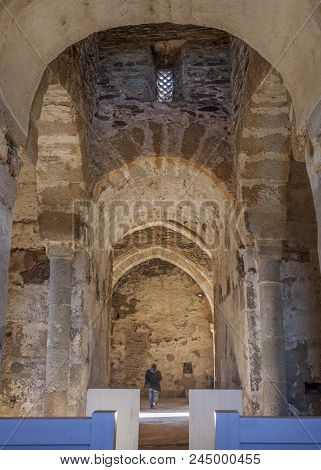 Visitor at Basilica of St Lucia del Trampal. Main nave view poster