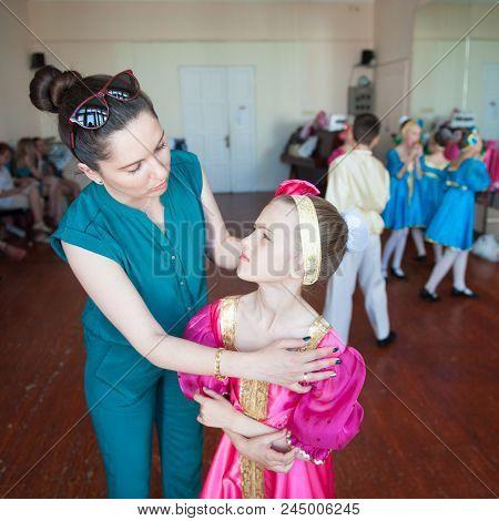 Mother And Her Daughter Prepare To Concert In Russian Ballet Dance School Indoors