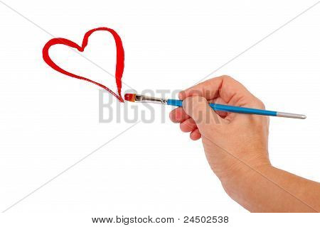 Hand draws a red heart