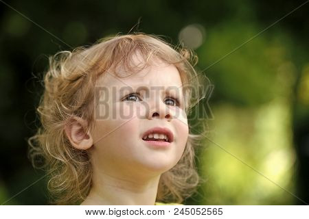Outdoor Fun, Leisure. Child, Childhood Concept. Toddler With Blond Curly Hair On Natural Landscape.