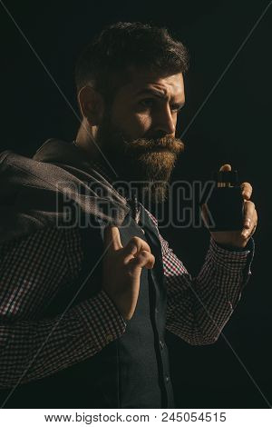 Silhouette Handsome Bearded Man In Stylish Retro Clothes With Bottle Of Perfume. This Cologne Is For
