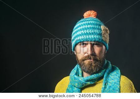 Male Fashion. Serious Man With Beard, Brutal Caucasian Hipster In Warm Scarf Wrapped Around His Neck