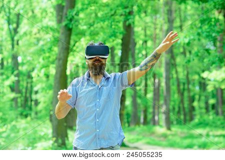 Gamer Man Wear Vr Glasses In Summer Forest. Gamer Play Virtual Reality Game With Mobile Device On Fr
