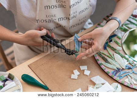 Workplace Of The Mosaic Master: Women's Hands Holding Tool For Mosaic Details In The Process Of Maki