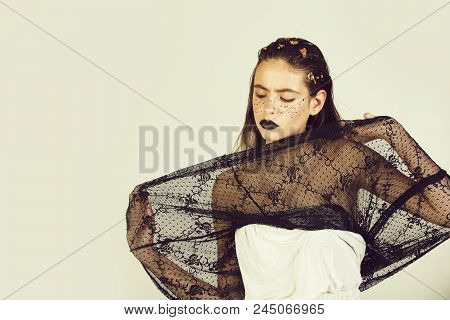Fashion Portrait Of A Girl In A Dress. Cute Woman Or Pretty Girl With Creative Makeup, Dark Lips Gol
