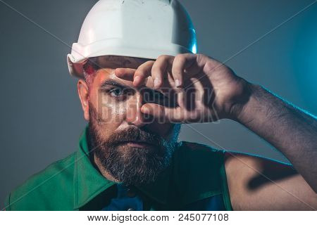 Hard Work. Builder Working With Construction Helmet. Portrait Architect Builder On Construction Site