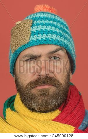 Men Autumn/winter Fashion. Serious Man Wiht Beard Wearing Warm Scarf Wrapped Around His Neck, Hat On