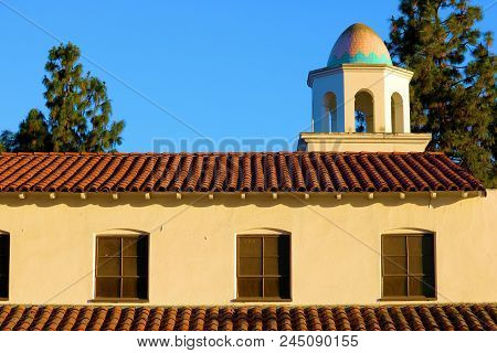 Historic Church With Spanish Architectural Design Including A Dome And Tiled Roof Taken In A Residen