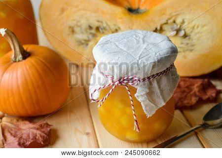 Autumn Still Life Of Homemade Pumpkin Jam On Natural Wood Table, Stock Photo Image