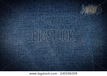 Denim Jeans Texture Or Denim Jeans Background With Old Torn. Old Grunge Vintage Denim Jeans. Stitche