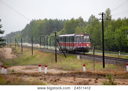 Railbus Passing The Forest