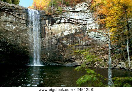 Cliffside Waterfall In Autumn