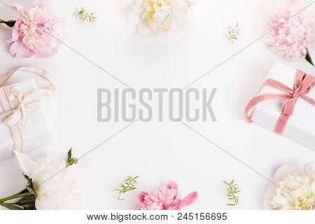 Festive Flower Composition On The White Wooden Background. Overh