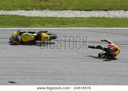 SEPANG, MALAYSIA - OCTOBER 21: Moto2 rider Mattia Pasini falls at turn 15 during free practice at the Shell Advance Malaysian GP 2011 on October 21, 2011 at Sepang, Malaysia.