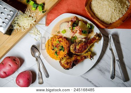 Colombian Cuisine Papas Chorreadas Roasted Chicken Legs And