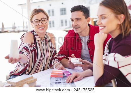 Married Couple. Young Married Couple Feeling Excited While Communicating With Interior Designer Of T