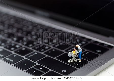 Miniature People : Shoppers For Shopping Online By Internet. Image Use For Retail Business, Marketin