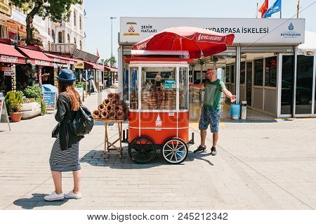 Istanbul, June 17, 2017: Sale Of A Traditional Turkish Bagel Called Simit. National Turkish Food. St