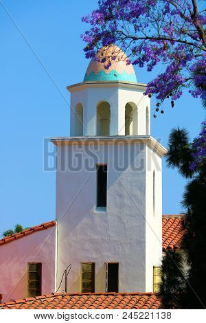 Historic Church With Spanish Architectural Design Including A Spanish Tiled Roof And Decorative Dome