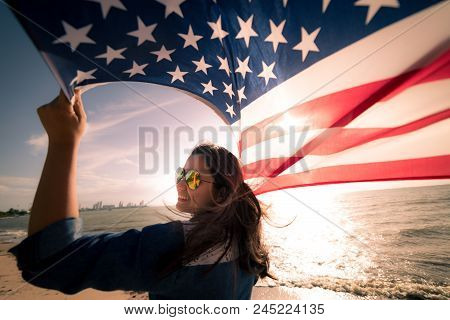 Usa Independence Day, 4 July. Close Up Oung Happy Woman Holding United States Of America Flag And Ru