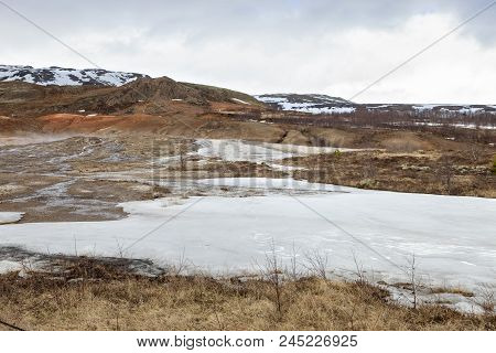 Snow Still Covers The Beautiful Landscape At Geysir In Iceland
