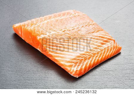 Raw Salmon Fillet On Gray Slate Background